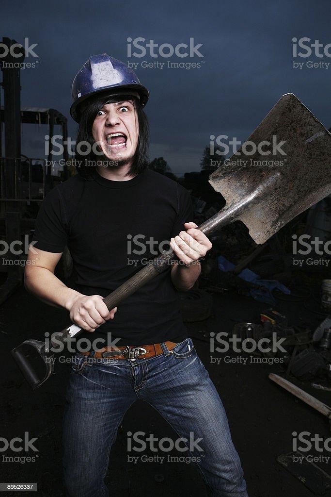 Темно-небесный мужчина, держащий Лопатка Стоковые фото Стоковая фотография