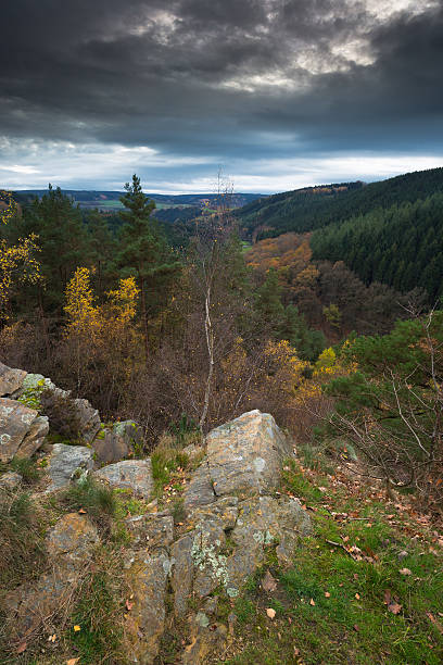 Dark sky over a beautiful rock formation in Belgium. A beautiful rock formation (Rocher de Falize) in the Belgium Ardennes during autumn. spa belgium stock pictures, royalty-free photos & images