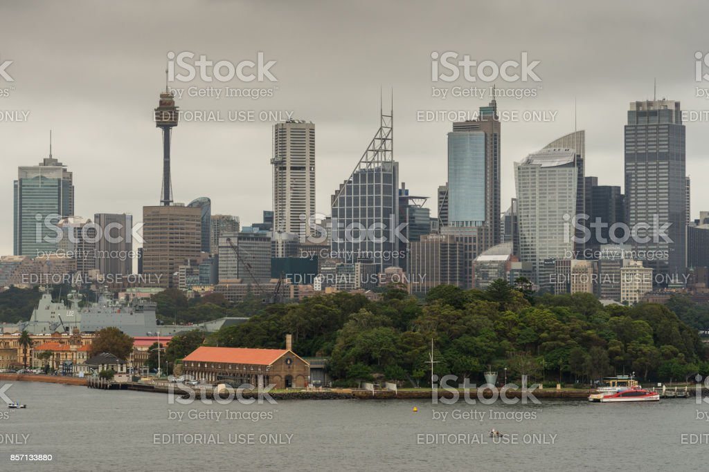 Dark sky over Sydney skyline with Garden Island, Australia. stock photo