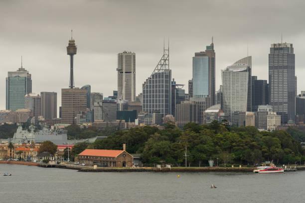 Dark sky over Sydney skyline with Garden Island, Australia. stock photo