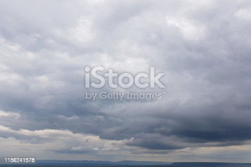 istock Dark sky with storm clouds 1156241578