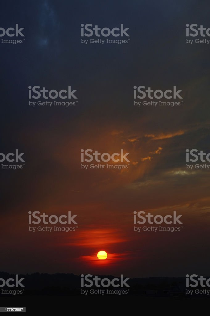 Dark sky with vibrant sun royalty-free stock photo