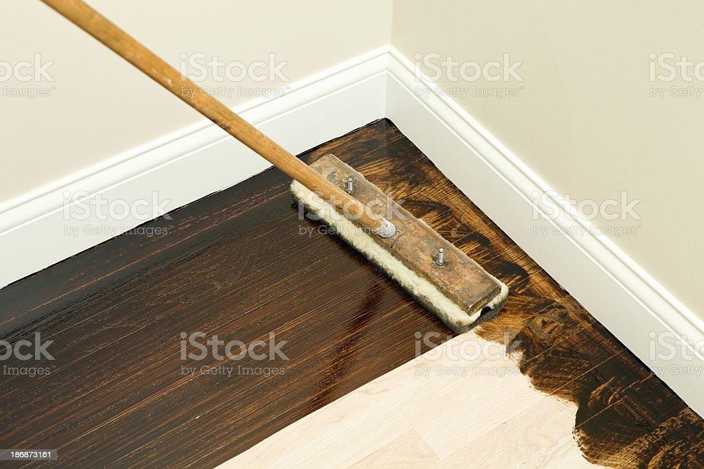 Dark Stain with Paintbrush on New Oak Hardwood Floor royalty-free stock photo