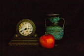 Long exposure photograph of clock, vase, and apple.