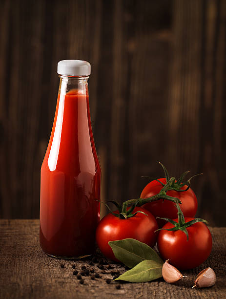 dark still life with ketchup and ingredients on the rough - ketchup bottle stock photos and pictures