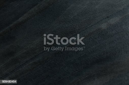 istock Dark stone background 939480454