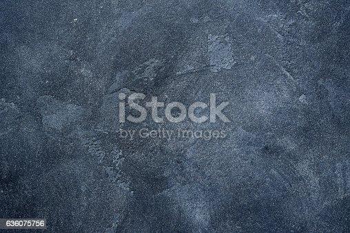istock Dark stone or slate wall. 636075756
