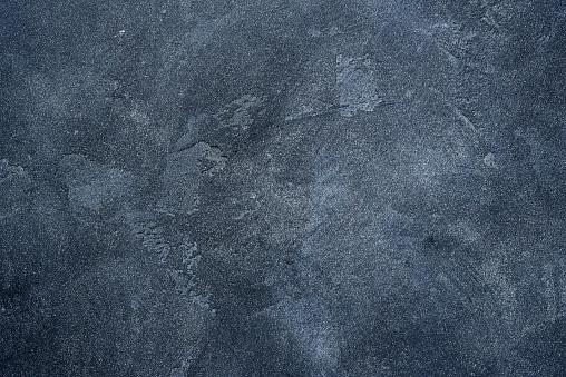Dark stone or slate wall.Grunge background.