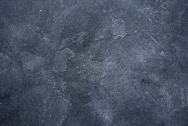 Dark stone or slate wall. - foto de stock