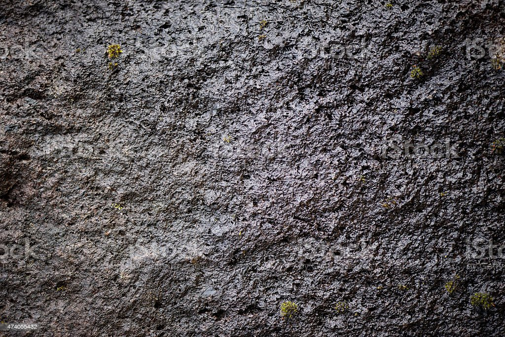 Dark stone texture / wet lava flows stock photo