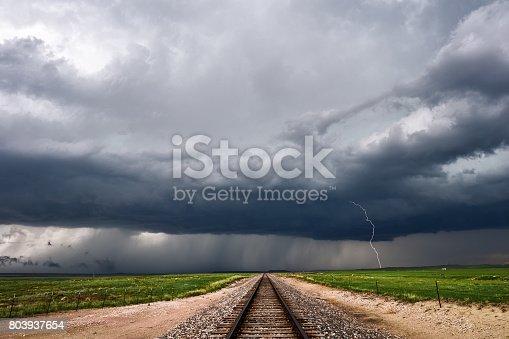 858837068istockphoto Dark storm clouds and lightning 803937654