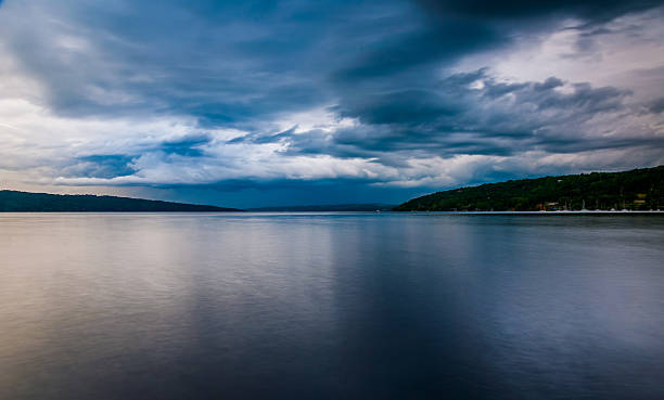 Dark storm clouds over Cayuga Lake, in Ithaca, New York. stock photo