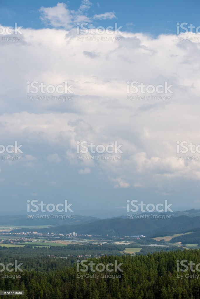 Dark storm clouds over meadow with green grass royalty-free stock photo