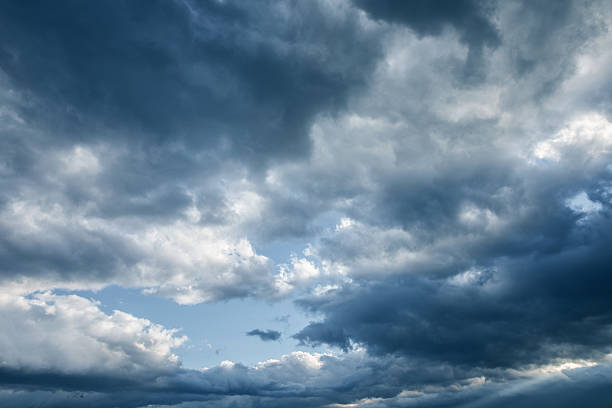 dark storm clouds stock photo