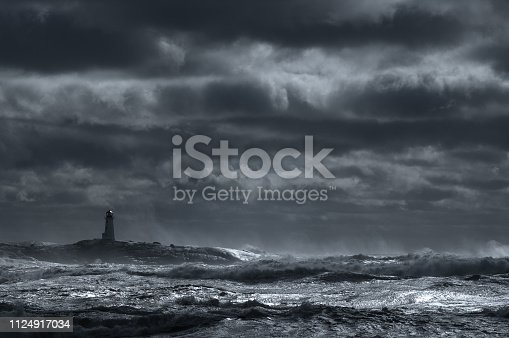 Giant waves break near the lighthouse at Peggy's Cove, Nova Scotia.
