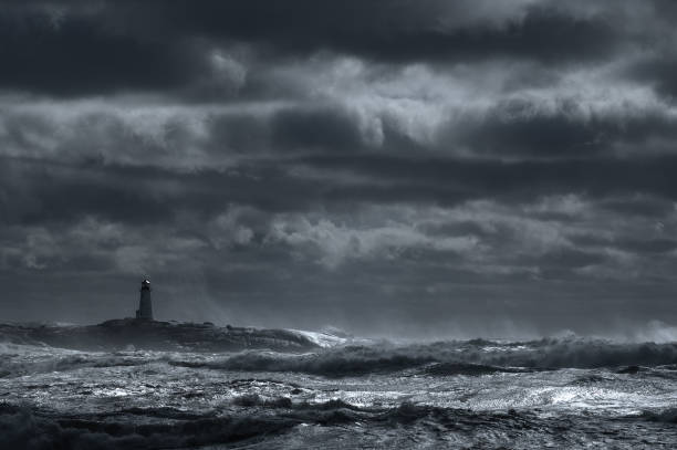 dark storm lighthouse - storm stock photos and pictures