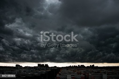 istock Dark stormy clouds over city 842195564