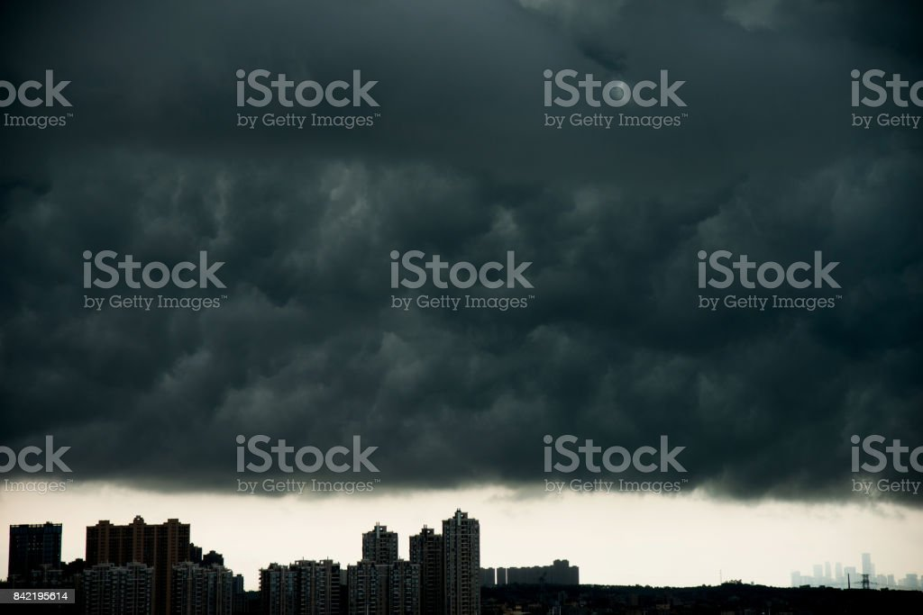 Dark stormy clouds over city.