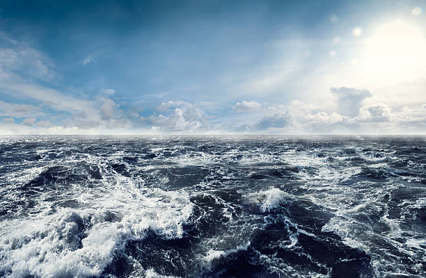 dark stormy sea waters - rough stock photos and pictures