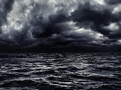 istock dark stormy sea with a dramatic cloudy sky 1281863832