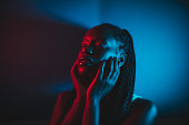 istock Dark studio shot of a young woman 1255041502