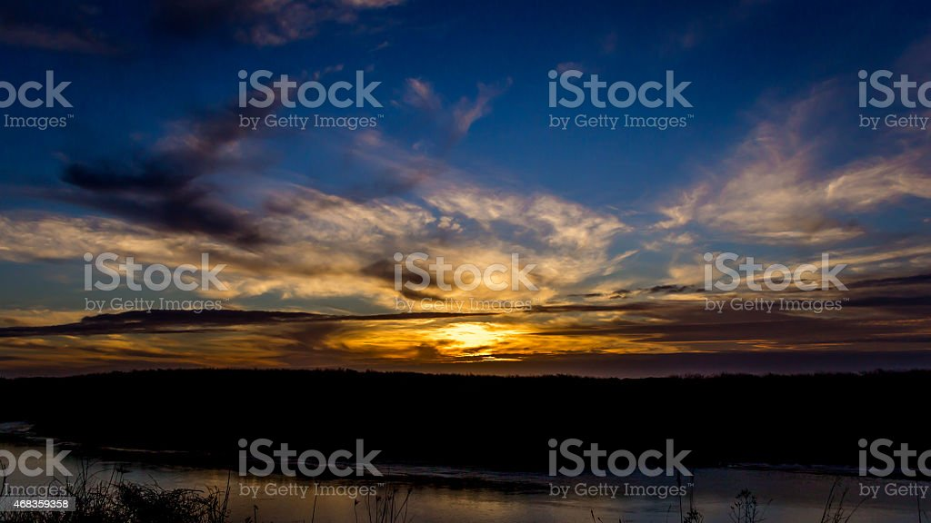 Dark Sunset Over the Water royalty-free stock photo