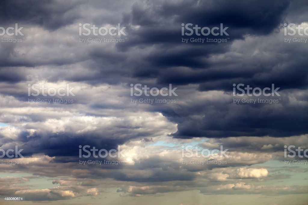 Dark sunset sky with clouds stock photo