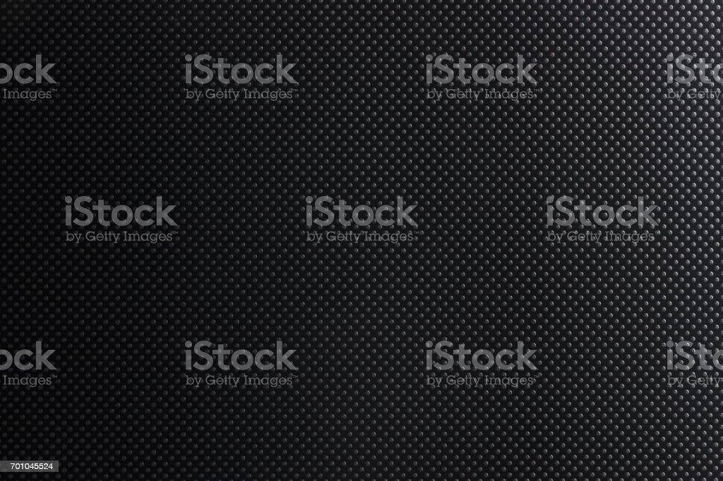 Dark texture of circles with gradient. Hard plastic stock photo