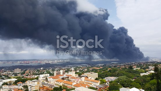 istock Dark toxic smoke hanging over the city of Durban. 838040294