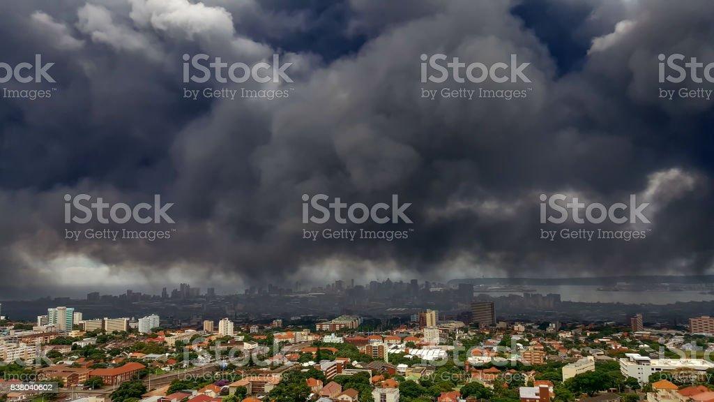 Dark toxic smoke hanging over the city of Durban. stock photo
