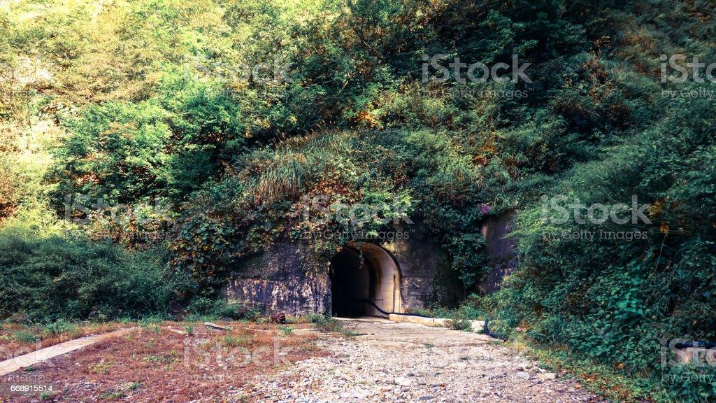Dark tunnel in mountain at Keyakidaira station in Kurobe gorge stock photo