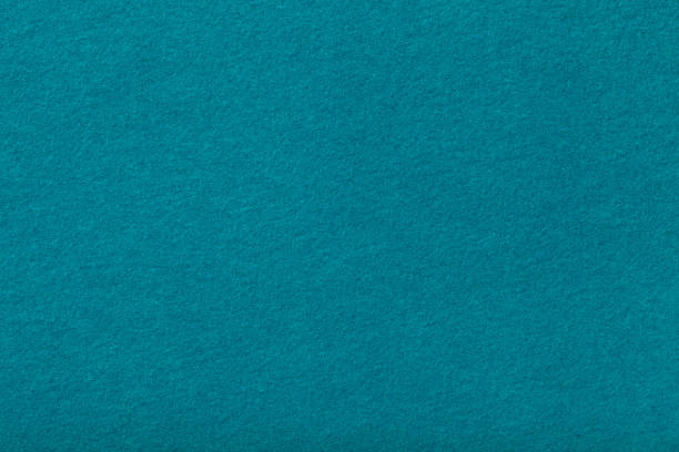 Dark turquoise matt suede fabric closeup. Velvet texture of felt. Dark turquoise matte background of suede fabric, closeup. Velvet texture of seamless cyan woolen felt. felt textile stock pictures, royalty-free photos & images
