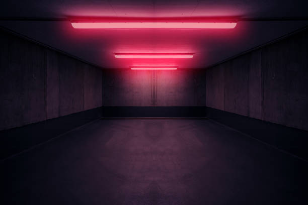 dark underground room with red neon light in basement or parking lot - - upiorny zdjęcia i obrazy z banku zdjęć