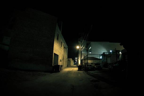Dark Urban City Alley at Night stock photo