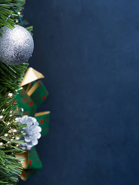 Dark vertical Christmas background with baubles and bow stock photo