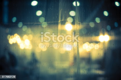 877010878 istock photo Dark vintage abstract background of night bokeh through light curtain 517663126