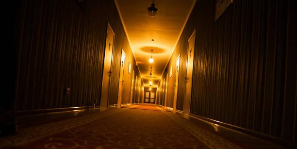 dark vintage motel corridor stock photo