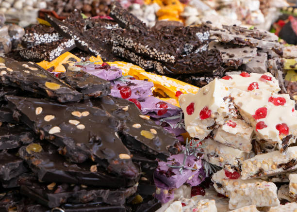 Dark, white and colors chocolate pieces crushed and cocoa beans, culinary background – zdjęcie