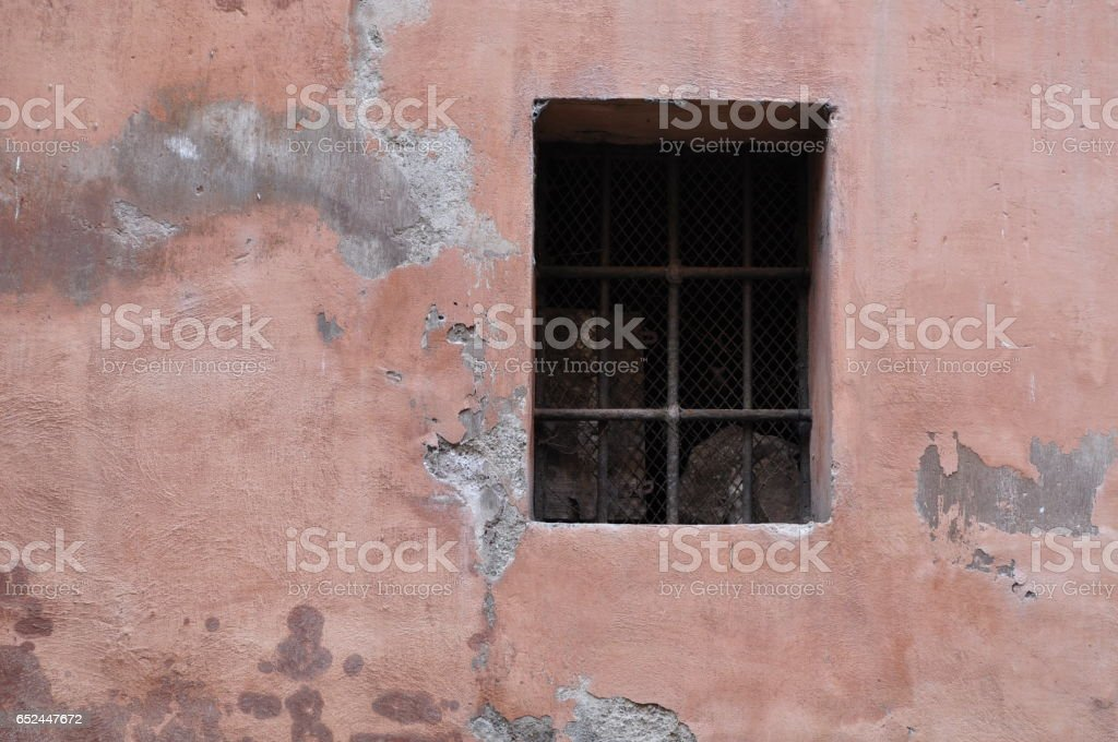 Dark window on a pink wall stock photo