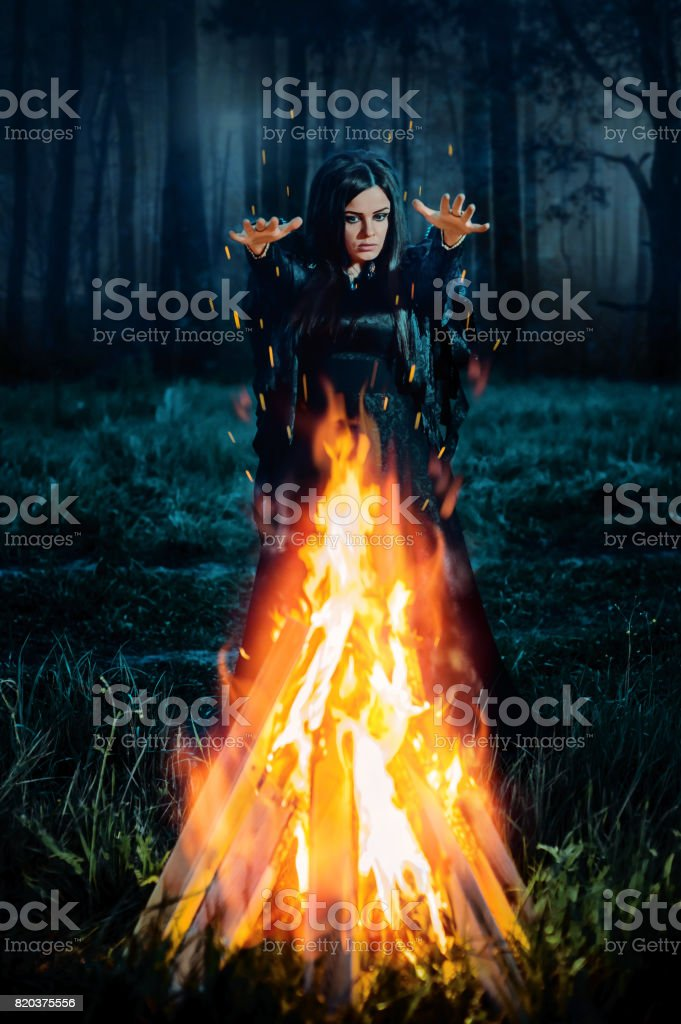 Dark witch conjures stock photo
