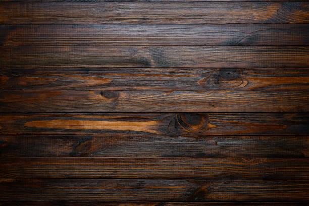 dunkles holz hintergrund - eichenholz stock-fotos und bilder