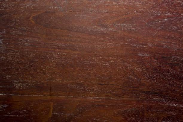 dunkles holz hintergrund - mahagoni braun stock-fotos und bilder