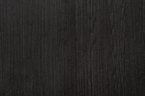 Dark wood grain background.