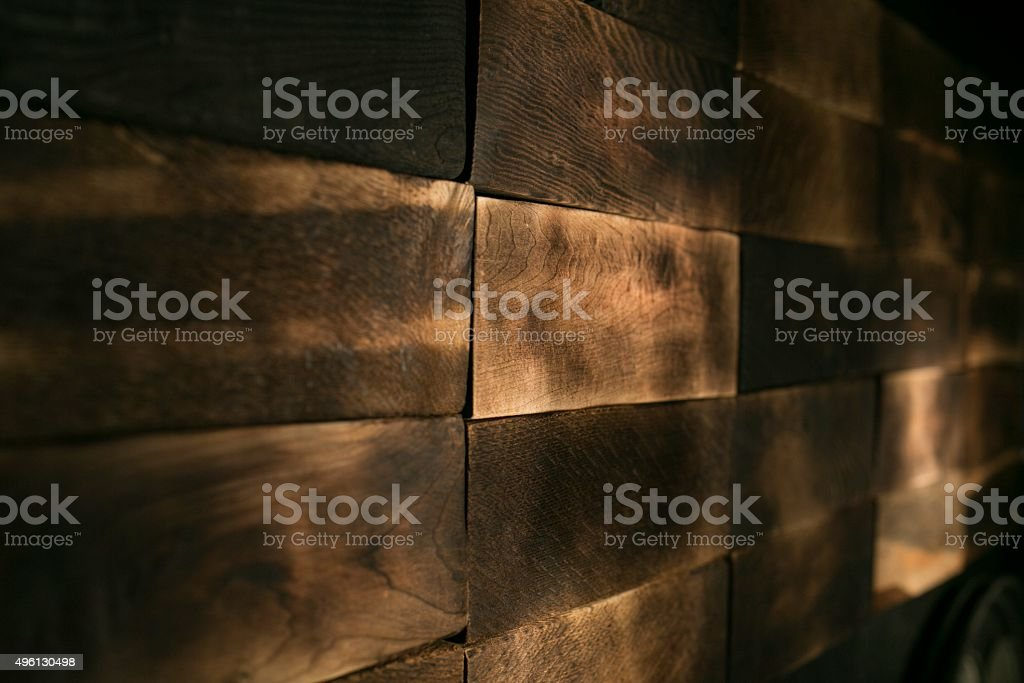 Dark wood planks stacked to a pile stock photo