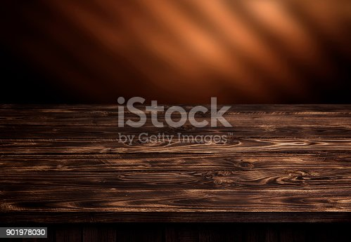 istock Dark wood table, brown wooden perspective interior 901978030