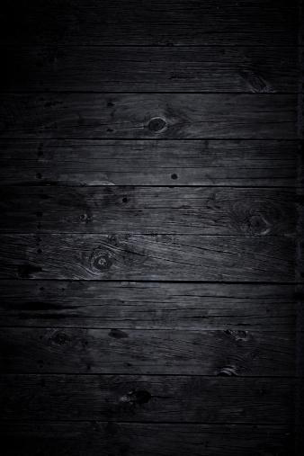 Horizontal black wooden panels.