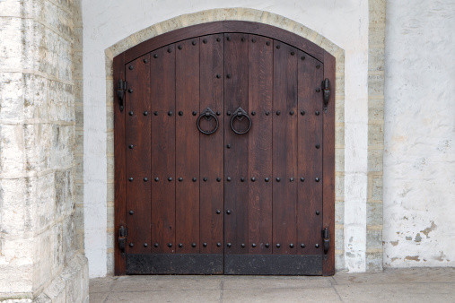 Dark wooden door with antique metal handles