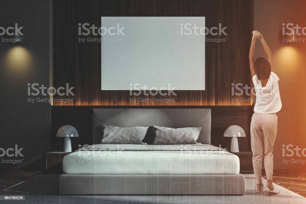 Dark wooden Scandinavian bedroom, poster, woman royalty-free stock photo