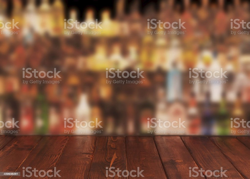 Dark wooden table against interior of bar stock photo
