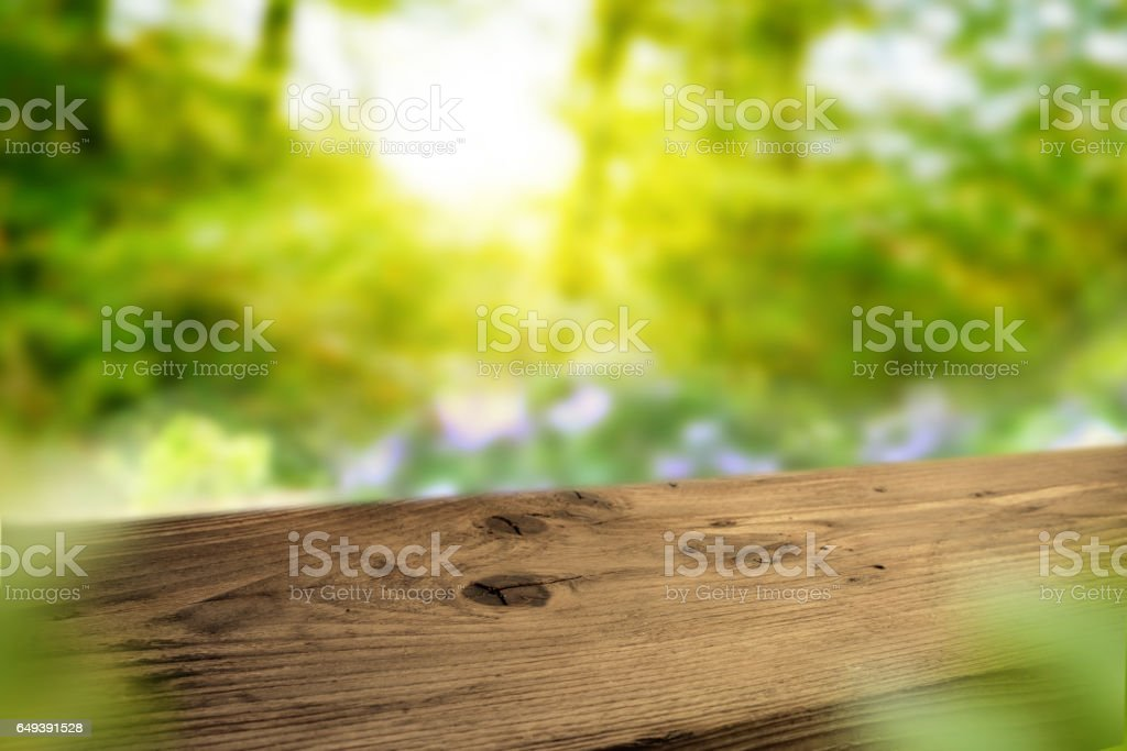Dark wooden table in a spring landscape stock photo